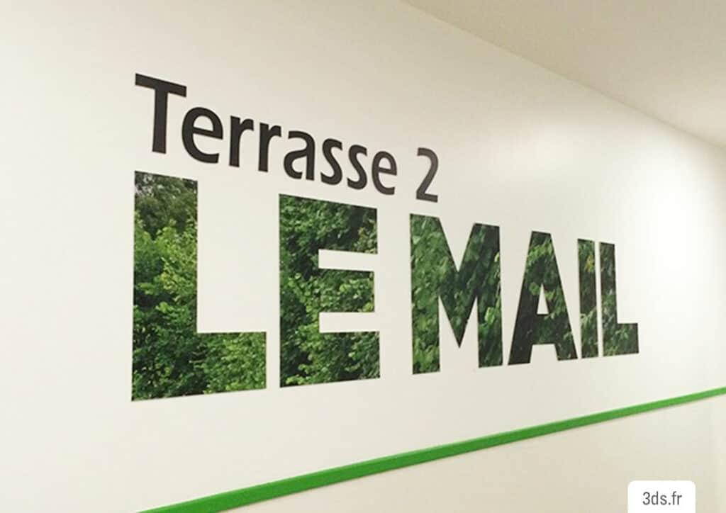 Signalétique imprimée végétal mur entreprise