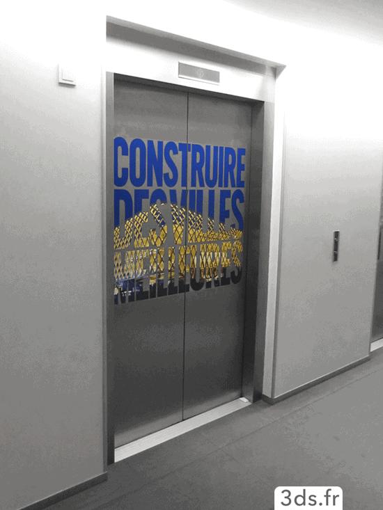 signalétique film adhésif sur ascenseur