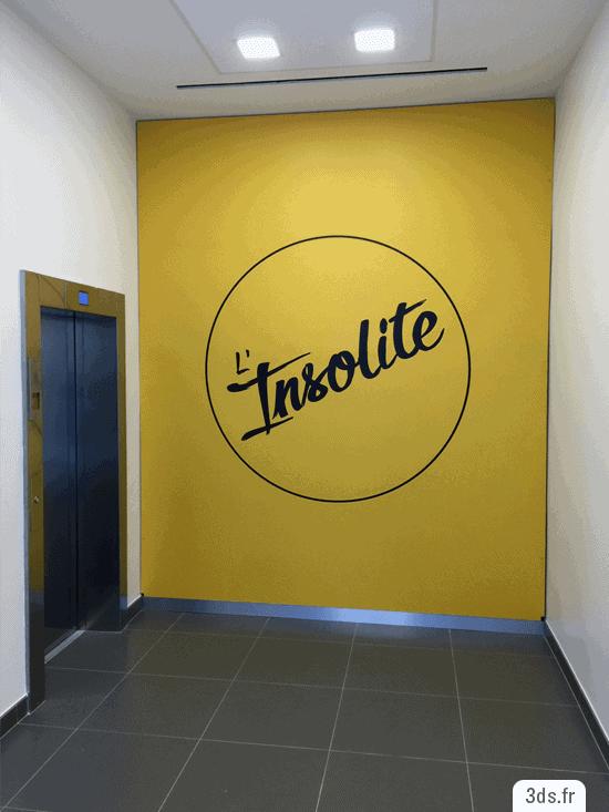 Toile tendue signalétique sortie ascenseur